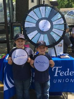 boys in front of prize wheel